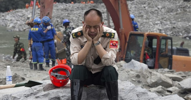The Latest: 10 bodies found, 93 missing in China landslide