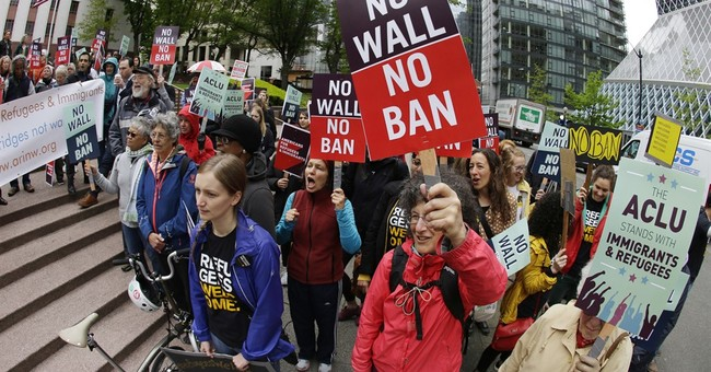 Q&A: Murkiness follows Supreme Court's action on travel ban