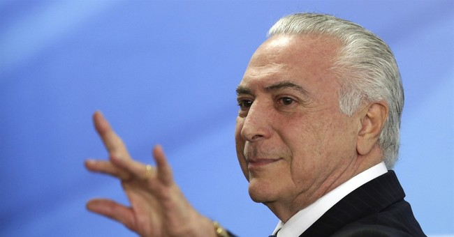 The Latest: Brazil president: corruption charge a 'fiction'