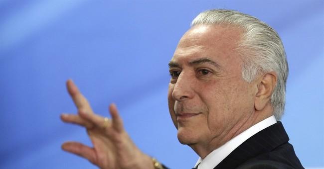 Brazilian President denies corruption charges