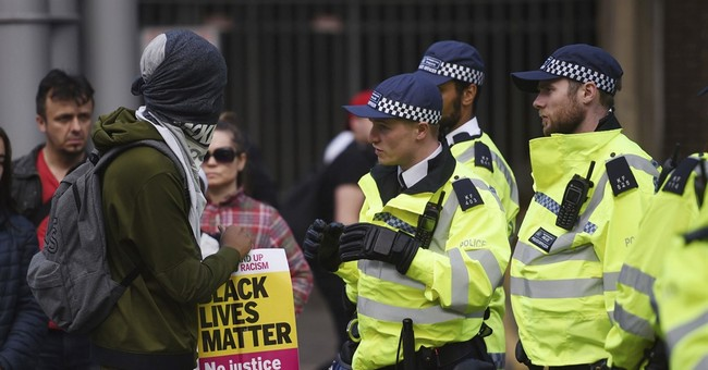 London protests over man's death leave 4 police hospitalized