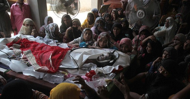 Pakistan holds collective burial for 130 killed in fuel fire