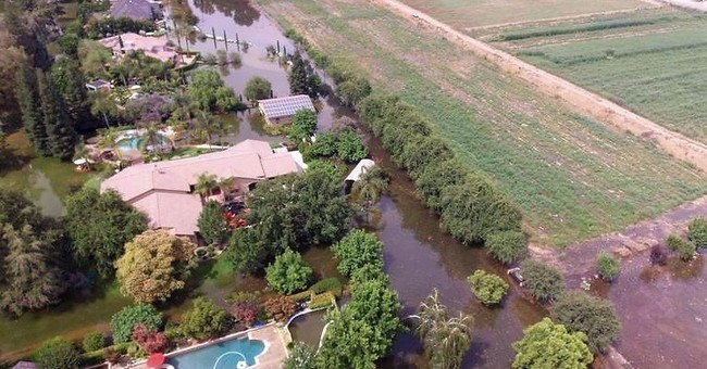 River swelling from snowmelt forces evacuation of 90 homes