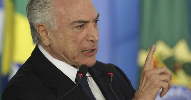 The Latest: Brazil's attorney general formally accuses Temer