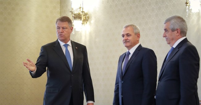 New leftist govt named in Romania, many ministers keep posts