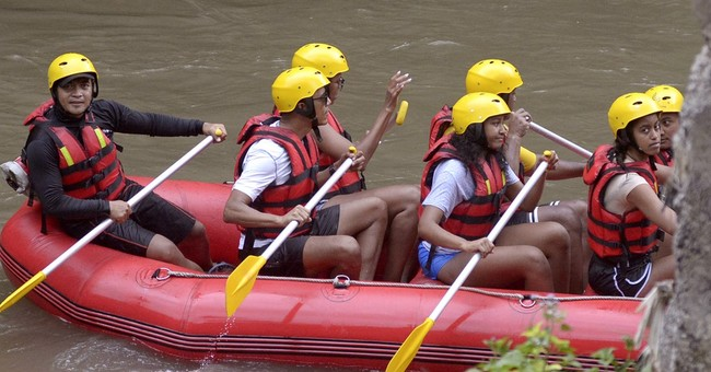 Obama and family go river rafting during Indonesia vacation