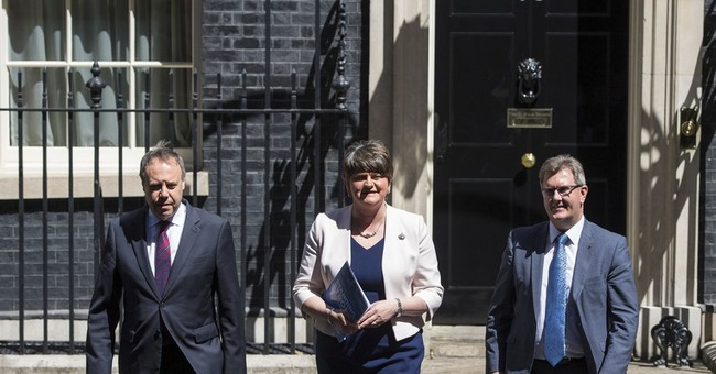 UK's May makes deal she needs to govern, but critics abound