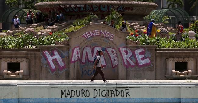 Venezuela minister says chopper fired 15 shots