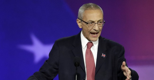 Clinton campaign chief has closed-door talk with House panel