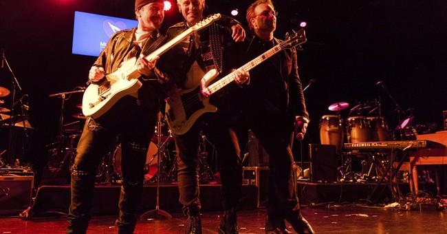 U2 bassist thanks band for helping him through addiction