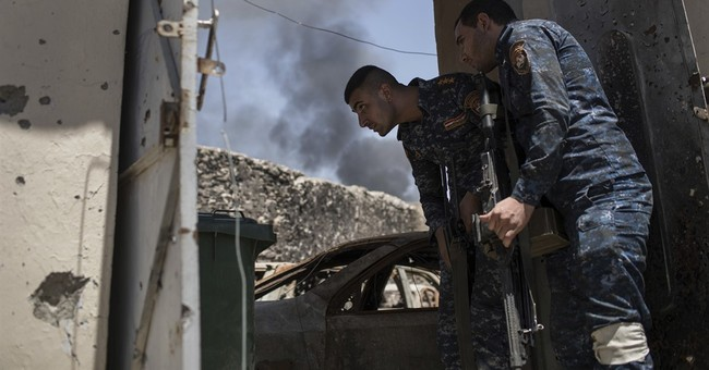 IS counterattacks in retaken parts of Mosul stall Iraq push