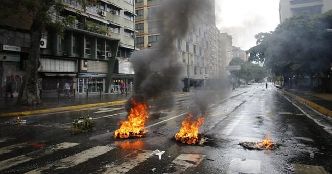 Venezuela hunts for copter pilot behind 'terrorist attack'