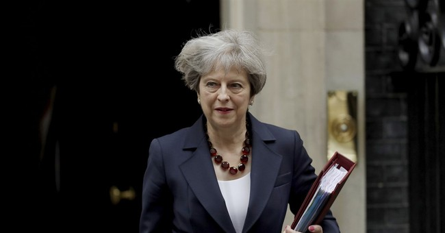 The Latest: UK's fragile government survives first vote
