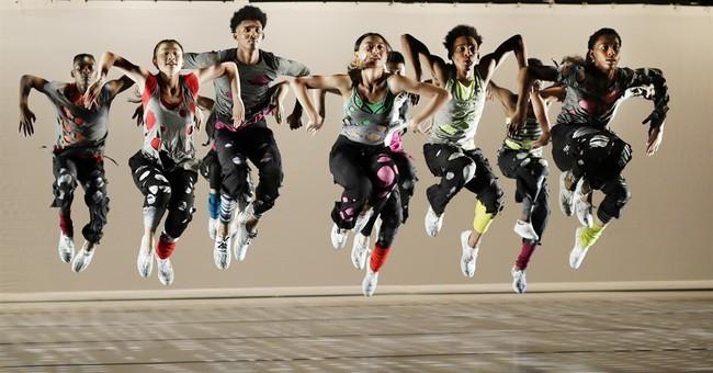 AP PHOTOS: Students soar at rigorous dance school