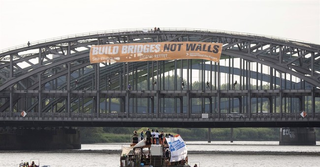 Activists protest for legal migration policies ahead of G20