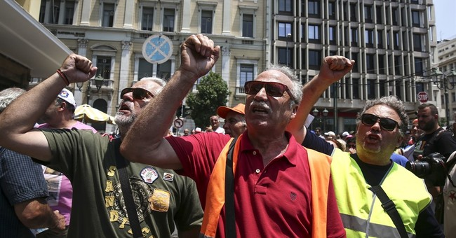 Greece eyes market return as debt dispute still simmering