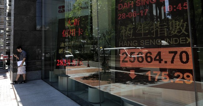 Global stocks fall on jitters over central bank policy