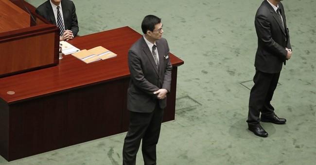 In final speech, Hong Kong leader warns on independence push