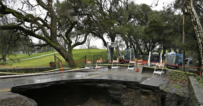 The Latest: First of 3 more storms slams California