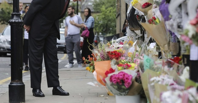 Retired judge to lead inquiry into deadly London tower fire