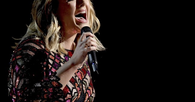 Adele shares devastation at canceling weekend London shows
