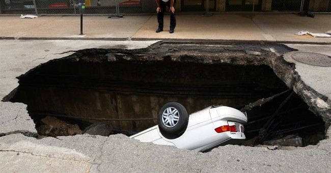 Sinkhole swallows up car in downtown St. Louis; no injuries