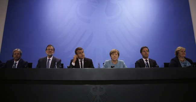 The Latest: Merkel says countries will work with US