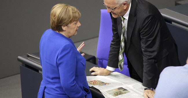 The Latest: Same-sex marriage bill splits Merkel's bloc