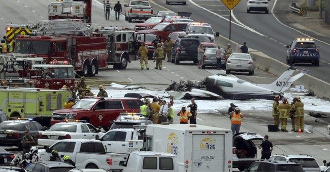 The Latest: Off-duty fireman rescued 2 from burning plane
