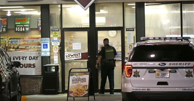 The Latest: Graphic, videos detail Baton Rouge police ambush