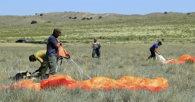 Diving from the sky, firefighters parachute to US wildfires