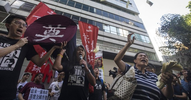 The Latest: Thousands on Hong Kong streets for annual march