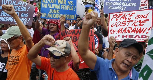 Militant siege, drug killings mark Duterte's stormy 1st year