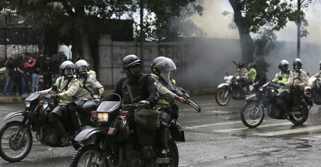 The Latest: Venezuela leader promotes investigated officer