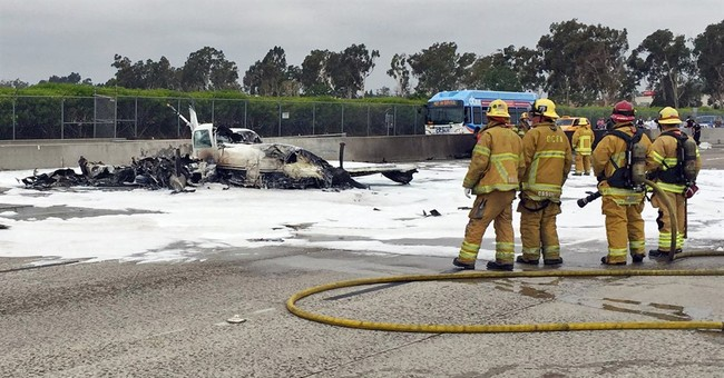 Pilot says 'Hey, we got a mayday!,' then crashes on freeway