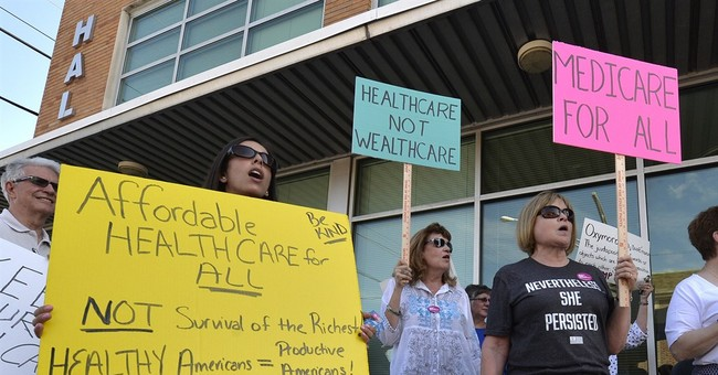 Health care: McConnell to stick with repeal and replace plan