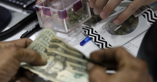 The Latest: Tourists buy in to recreational pot in Nevada