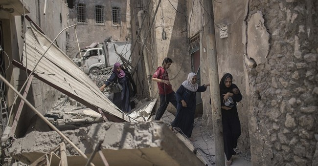 The Latest: Officer says Iraq troops faced 7 female bombers