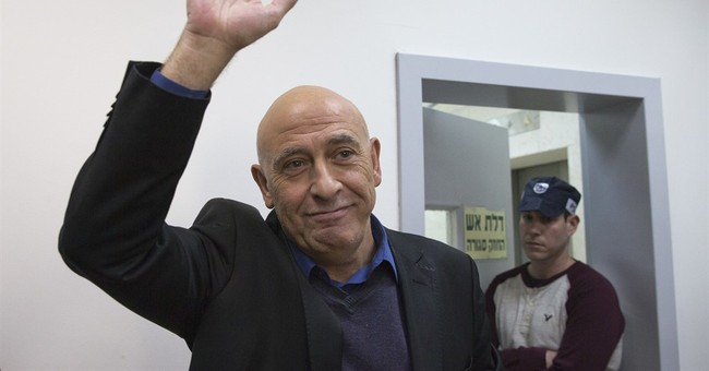 Arab Israeli ex-lawmaker heads to prison with 'pride'