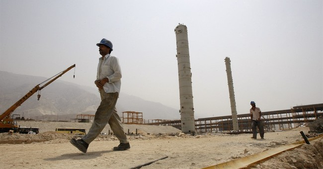 Iran signs $5B gas deal with France's Total, Chinese firm