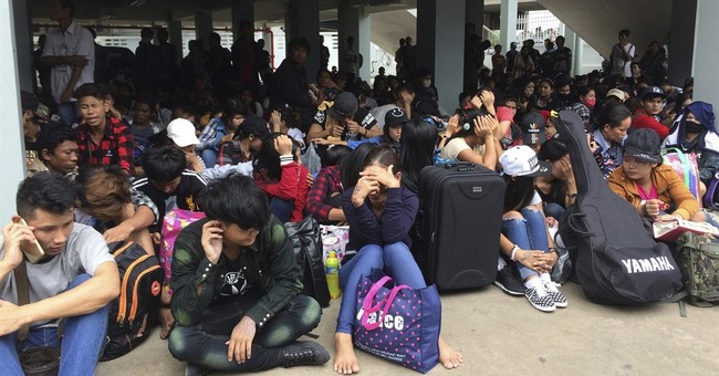 New Thai labor rules send migrant workers packing for home