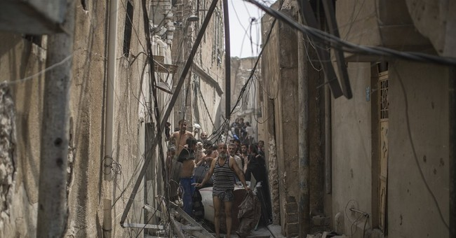 AP PHOTOS: Scared and nearly naked, an Iraqi man flees Mosul
