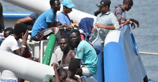 The Latest: Italy says migrant arrivals up 20 pct this year