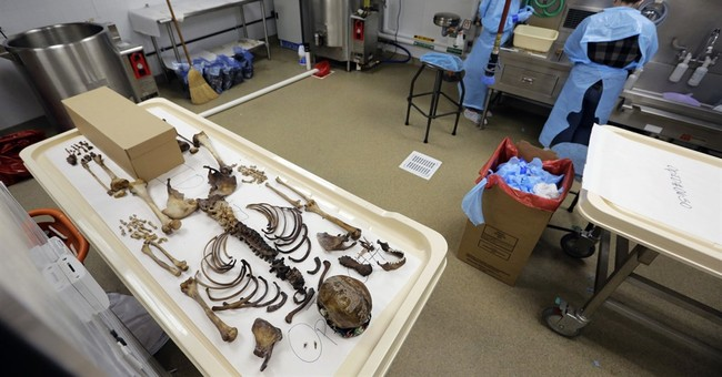 FBI, groups at odds over efforts to ID immigrant remains