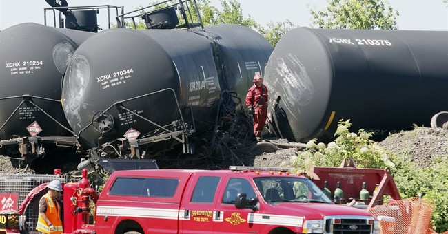Cleanup continues at derailed freight train site, oil spill