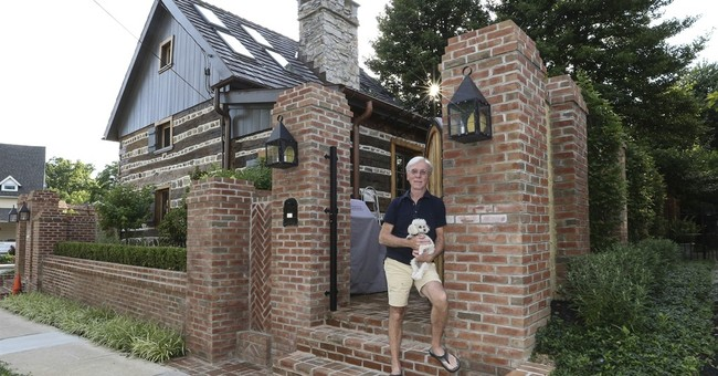 Man finds out small house is actually 300-year-old log cabin