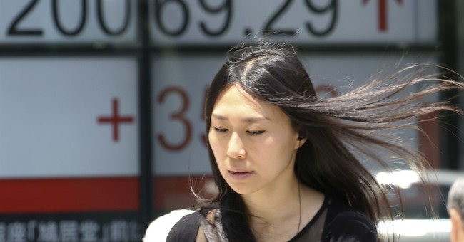 Asian stocks mixed after Wall Street gains