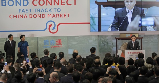 China widens investor access as bond trading link launches