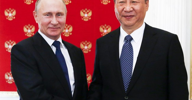 The Latest: Russia, China seek halt of N Korea weapons tests