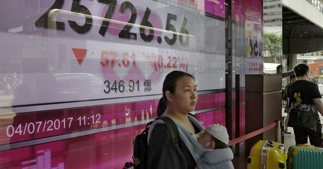 Asian shares subdued as missile fallout weighs on sentiment
